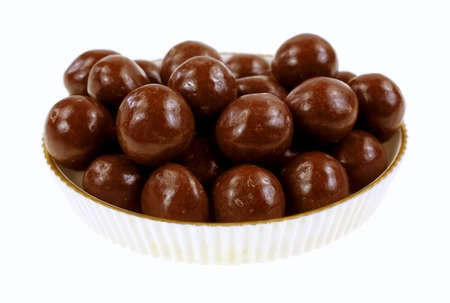 carmel: Chocolate covered carmel balls in a small fluted edge dish  Stock Photo