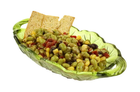 A green glass serving dish with edamame soy bean salad and crackers  Stock Photo - 17227357