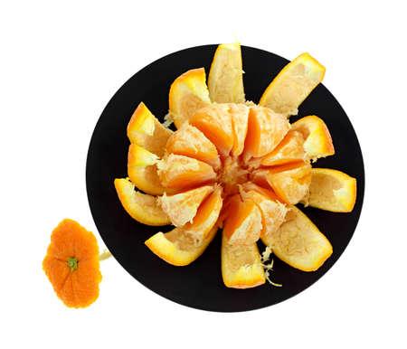 trivet: A large peeled navel orange segments on black trivet