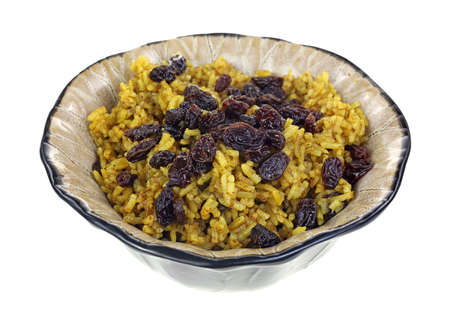 angle view: An angle view of a dish of spicy rice and raisins. Stock Photo