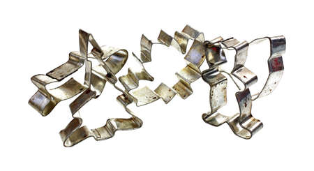 A group of old shaped metal cookie cutters. photo