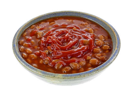angle view: An angle view of canned baked beans with ketchup