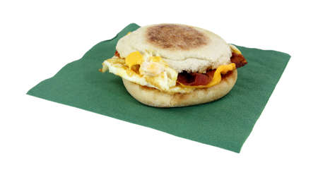 A nice view of a bacon egg and cheese sandwich  on napkin.  photo