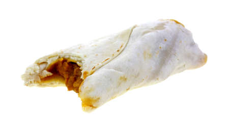 A  bite of a single burrito on white. photo