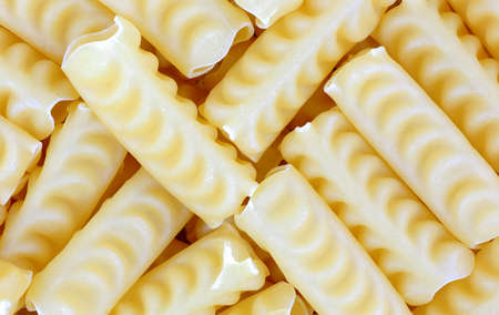 firmness: A close overhead view of curly tubular pasta  Stock Photo