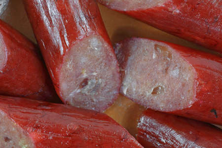 casing: A close view of  a sliced beef stick in casing. Stock Photo