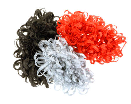 pony tail: A group of colorful stretchy ribbon pony tail holders.