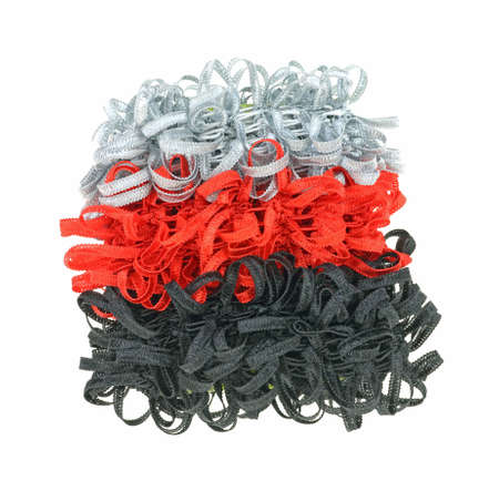pony tail: A stack of colorful narrow curly ribbon pony tail holders.