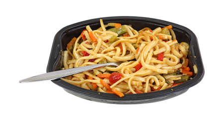angle view: An angle view of noodles and vegetables in black tray.