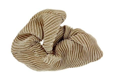 scrunchy: A shiny elasticized folded beige fabric and softly pleated scrunchy hair holder.