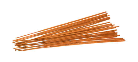 incense sticks: A side view of a group of  long aromatic incense sticks with a rough and gritty flammable texture