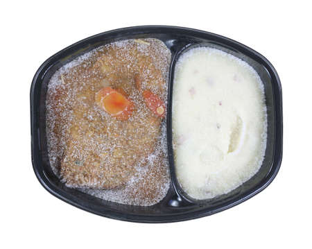 A prepared frozen meatloaf in gravy meal with mashed potatoes. Stock Photo - 24024738