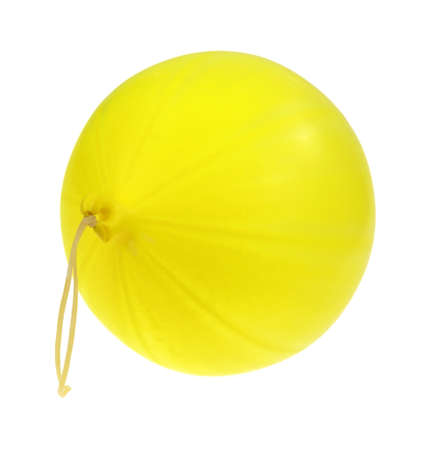 springy: A side view of a new inflated yellow punch ball with an attached  springy stretchy handle on a white background.