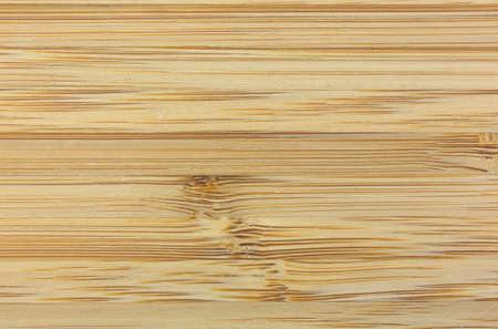 gouged: A close view of a used wood cutting board.