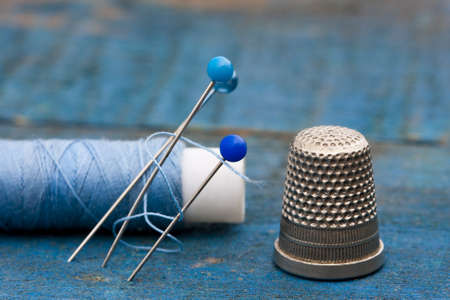 thread, needles and thimble photo