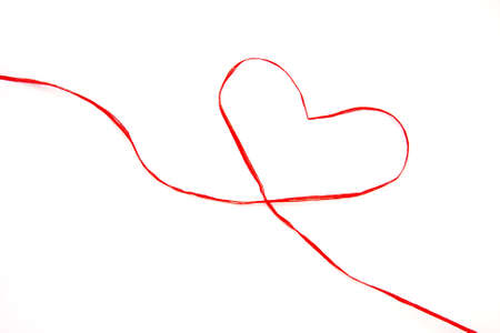 gift ribbon drawing a heart photo