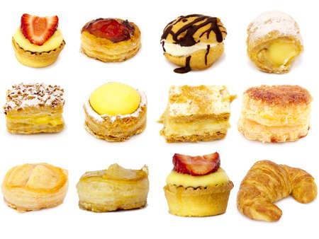 grasas saturadas: pasteler�a aisladas sobre fondo blanco Foto de archivo
