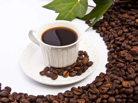 taza de café y café tostado Granos de Foto de archivo