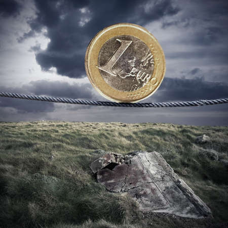 euro currency tightrope in the desolate landscape photo