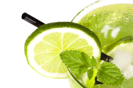 glass of refreshing summer drink with lemon and leaf