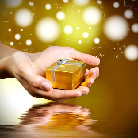 hands with gifts and funds with bright lights Stock Photo - 17311549