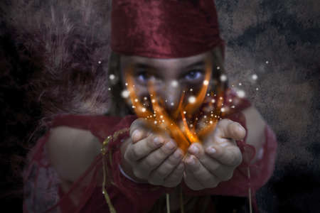 Young girl with magic hands photo