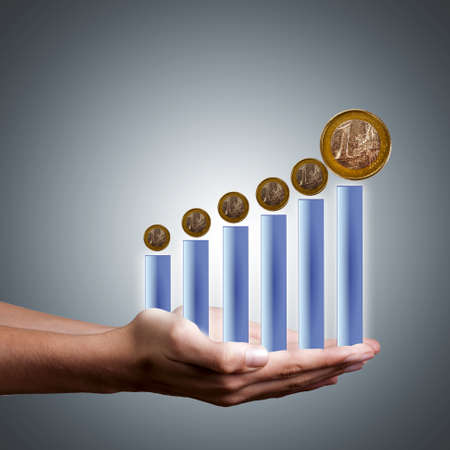 bar graph on hand with euro coins Stock Photo