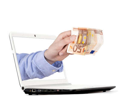 hand coming out of the computer for electronic payment Stock Photo - 18877102