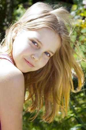 loose hair: girl with loose hair looking at camera Stock Photo