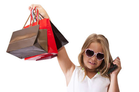girl with shopping bags isolated on white photo