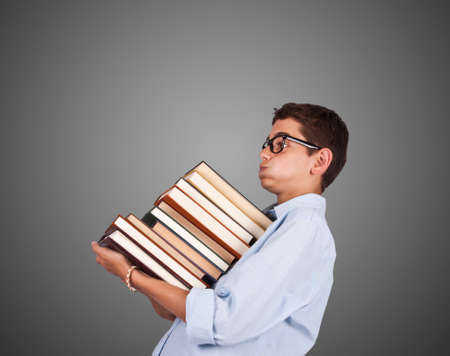 woman carrying stack of books isolated on gray Stock Photo