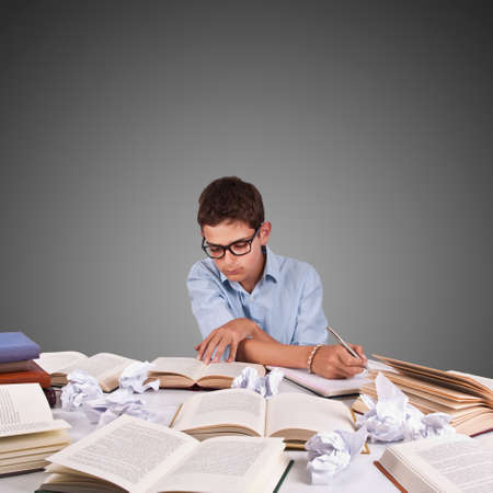 selectivity: girl studying at the desk with lot of work desk