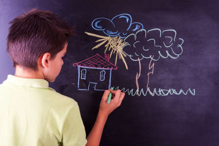 boy drawing on the blackboard photo