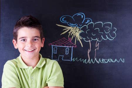 boy drawing on the blackboard Stock Photo - 23050800
