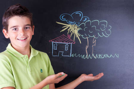 boy drawing on the blackboard Stock Photo - 23050802