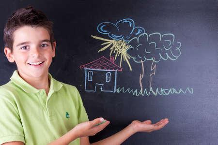 boy drawing on the blackboard Stock Photo - 23050802