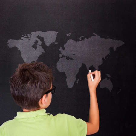 child on the Board with world map photo