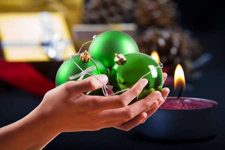 endearing: hand with christmas balls