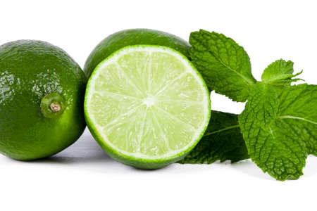 mint leaves: limes with mint leaves on white background