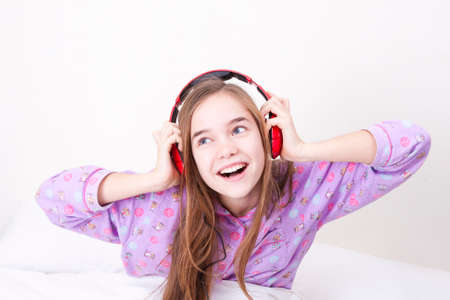 sympathetic: Happy smiling girl with headphones listening to music