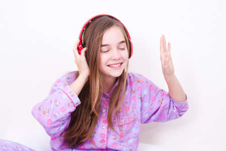 Happy smiling girl with headphones listening to music Stock Photo - 25060271