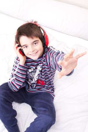 preteen boy listening music in the room photo