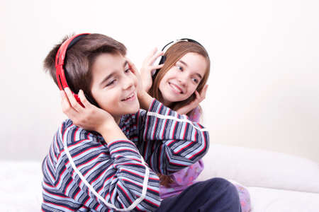 preteen model: young guys listening music in the room