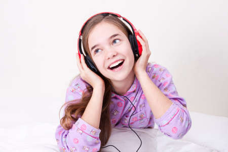 Happy smiling girl with headphones listening to music Stock Photo - 25060284