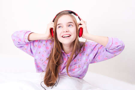 Happy smiling girl with headphones listening to music Stock Photo - 25060286