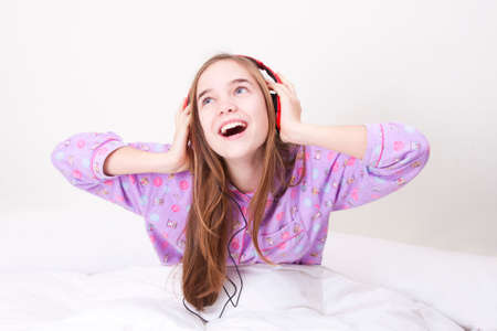 Happy smiling girl with headphones listening to music Stock Photo - 25060287
