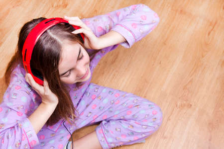 Happy smiling girl with headphones listening to music Stock Photo - 25060294