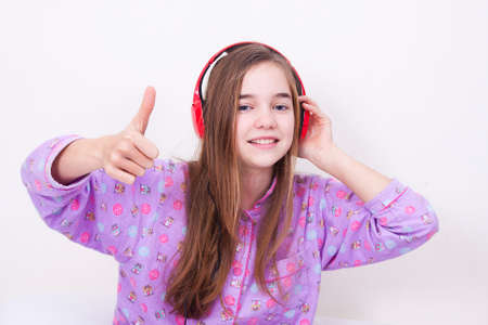 Happy smiling girl with headphones listening to music photo