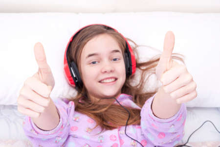 Teen girl listening music in the room photo