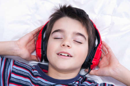 child model: preteen boy listening music in the room